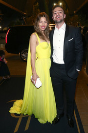 Jessica Biel paired her dress with a white hard-case clutch by Tyler Ellis.