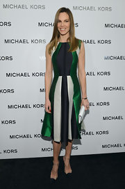 Hilary Swank sat front row at Michael Kors in this green paneled cocktail dress.