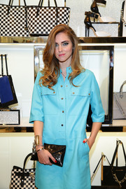 Chiara Ferragni kept it classic and chic with this black patent leather envelope clutch at the Michael Kors Milano cocktail party.