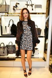 Susanna Giaroli layered a fur-lined brown suede coat over her mini dress for a fiercer finish.