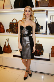 Mary Charteris looked fierce in a strapless black and silver corset dress by Michael Kors during the designer's Milano cocktail party.
