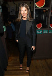 Nina Garcia suited up in a sleek black tux for the Michael Kors and David Downton collaboration dinner.