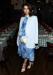 Emily Robinson pulled her look together with a white envelope clutch.