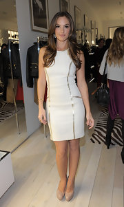 Minka Kelly wore a white sheath dress with gold style lines for the Michael Kors celebration.