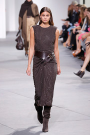 Taylor Hill was punk-glam on the Michael Kors runway in a beaded brown midi dress teamed with an oversized leather belt.