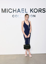 Sistine Stallone showed off her svelte figure in a body-con navy tank dress by Michael Kors during the brand's fashion show.