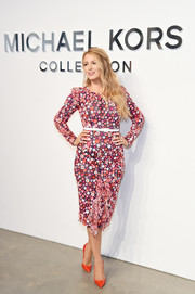 Blake Lively styled her look with red-orange pumps by Christian Louboutin.
