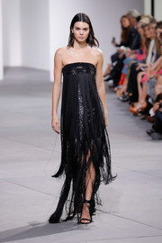 Kendall Jenner was flapper-glam in a fringed, strapless gown on the Michael Kors runway.
