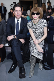 Anna Wintour opted for a monochrome floral sheath dress when she attended the Michael Kors fashion show.