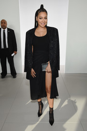 A simple satin clutch completed La La Anthony's all-black attire.