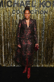 Regina King sealed off her ensemble with a red box clutch.