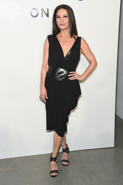 Catherine Zeta-Jones complemented her LBD with a pair of zip-embellished strappy sandals, also by Michael Kors.