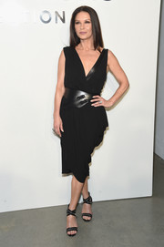 Catherine Zeta-Jones looked ageless in a draped wrap dress by Michael Kors during the brand's fashion show.