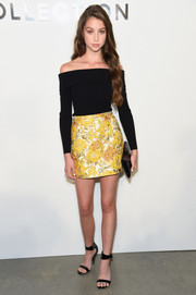 Carys Zeta Douglas brightened up her top with a yellow jacquard mini skirt, also by Michael Kors.