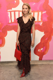 Dianna Agron went for edgy styling with a pair of red python boots, also by Michael Kors.