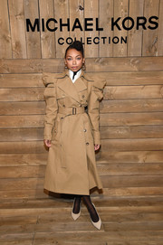 Logan Browning rocked a puff-sleeved trenchcoat by Michael Kors during the brand's Fall 2020 show.