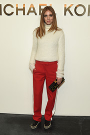Chiara Ferragni cozied up in a toasty-looking Michael Kors mohair crewneck sweater layered over a turtleneck for the label's fashion show.