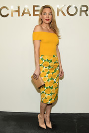 Kate Hudson continued the bright and cheery vibe with a floral pencil skirt, also by Michael Kors.