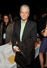 We love that Michael Douglas opted for color in his button-down shirt.  The green sage shirt adds a nice touch to his suit at the fashion show.  Michael Kors would approve.