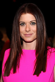 Debra Messing smoothed out her curly tresses for the Michael Kors fall 2012 fashion show.