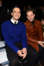 Cheyenne Jackson added a pop of color to his otherwise all black look with a black and blue striped sweater at the Michael Kors Fall 2013 runway show.