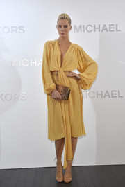 Poppy Delevingne was a classic beauty in this draped yellow dress by Michael Kors during the brand's Ginza flagship store opening.