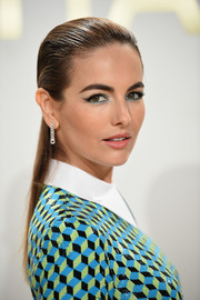 Camilla Belle styled her look with an elegant pair of dangling diamond chain earrings.