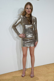 Halston Sage gleamed in a body-con gold mini dress by Michael Kors during the label's fragrance launch.