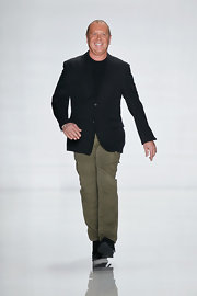 Michael Kors stuck to his signature basics like this black blazer which he donned for his Fall 2013 runway show.