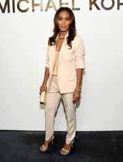 Sticking to a monochromatic palette, Jada Pinkett Smith completed her outfit with a pair of Michael Kors slacks.