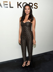 Olivia Munn looked sassy in a strapless jacquard jumpsuit by Michael Kors during the label's fashion show.