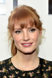 Jessica Chastain shaved off years with this girly ponytail she wore to the Michael Kors fashion show.