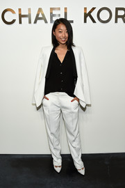 Margaret Zhang attended the Michael Kors fashion show looking androgynous-chic in a white pantsuit teamed with a black button-down.
