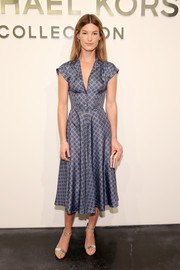 Hanneli Mustaparta looked breezy-chic in a fit-and-flare print dress during the Michael Kors fashion show.