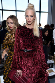 Poppy Delevingne accessorized with a skinny black belt for some shape to her loose dress at the Michael Kors fashion show.