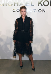 Nina Agdal kept it fun in a fringed dress with sheer sleeves and a button-down neckline at the Michael Kors Spring 2017 show.