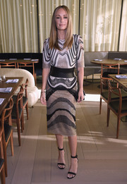 Catt Sadler cut a sleek figure in her neutral printed midi dress with a wide leather belt at the Michael Kors Spring 2017 show.