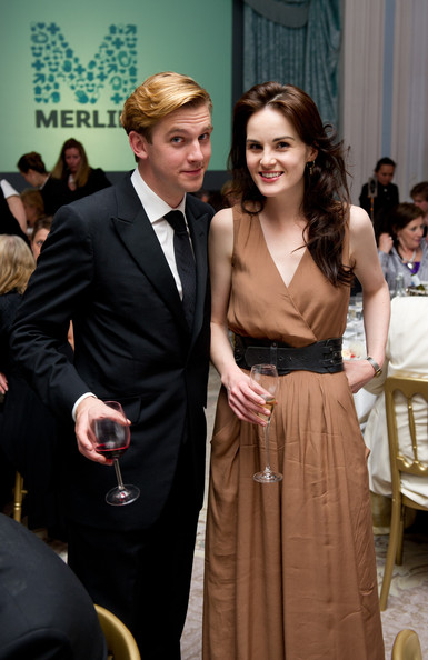 Michelle Dockery Oversized Belt [suit,formal wear,dress,fashion,event,hairstyle,tuxedo,gown,haute couture,fashion design,michelle dockery,thomas howes,downton abbey - raising money for merlin - the medical relief charity,an evening with downton abbey - raising money for merlin - the medical relief charity,the savoy hotel,united kingdom,london]