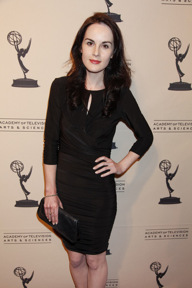 Michelle Dockery Leather Clutch [clothing,little black dress,dress,cocktail dress,shoulder,fashion,formal wear,waist,footwear,leg,michelle dockery,leonard h. goldenson theatre,north hollywood,california,academy of television arts sciences,writers peer group celebrates the 63rd primetime emmy awards,writers peer group reception,63rd primetime emmy awards]