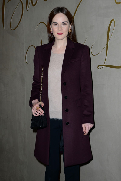 Michelle Dockery Statement Ring [film,clothing,outerwear,coat,overcoat,fashion,duster,trench coat,sleeve,formal wear,blazer,michelle dockery,burberry festive film - arrivals,england,london,burberry,premiere,premiere]