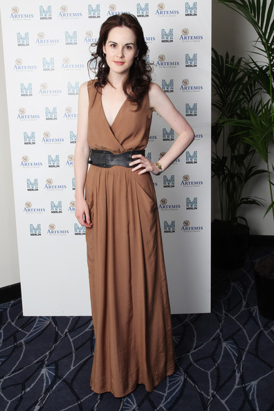 Michelle Dockery Wrap Dress [clothing,dress,shoulder,fashion,fashion model,lady,bridal party dress,brown,formal wear,a-line,downton abbey - raising money for merlin - the medical relief charity,united kingdom,london,the savoy hotel,michelle dockery]
