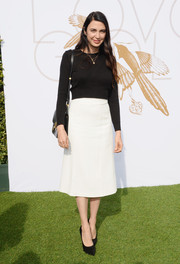 Shiva Rose complemented her sweater with a simple white A-line skirt.