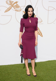 Dita Von Teese complemented her dress with an elegant tasseled clutch.