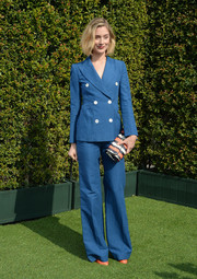 Caitlin Fitzgerald sported a '70s vibe in this flared blue pantsuit during the LoveGold luncheon.