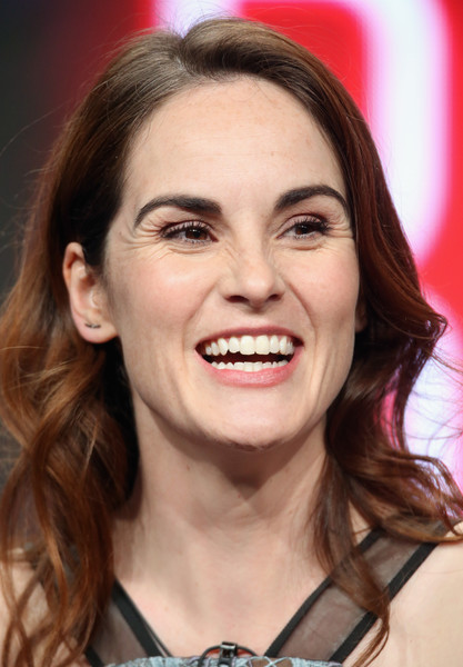 Michelle Dockery Long Wavy Cut [hair,face,eyebrow,facial expression,hairstyle,chin,skin,smile,lip,beauty,michelle dockery,turner,portion,tbs/good behavior,the beverly hilton hotel,beverly hills,california,summer tca,panel discussion,television critics association summer tour]