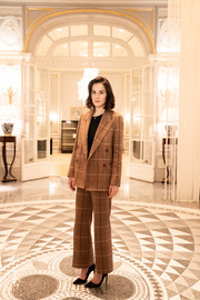 Michelle Dockery posed for her Rome Film Festival portrait wearing a tan plaid pantsuit by Acne Studios.