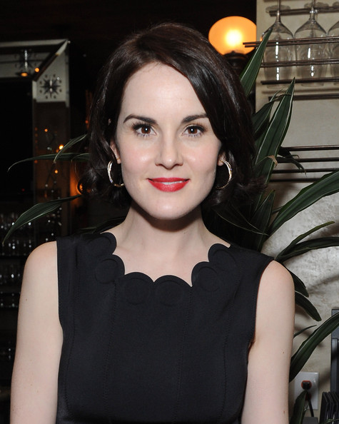 Michelle Dockery Short Curls [hair,face,lip,beauty,hairstyle,fashion,black hair,dress,little black dress,haute couture,michelle dockery,anonymous content,anticipation,west hollywood,california,anonymous content hbo celebrates the golden globes in anticipation of the premiere of hbo,true detective,rivabella,pre-golden globes event]