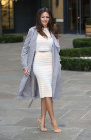 Michelle Keegan smartened her casual separates with a gray trenchcoat.