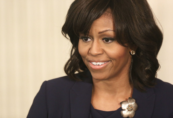 Michelle Obama Flower Brooch [jackie robinson movie,hair,hairstyle,layered hair,chin,lip,black hair,bob cut,smile,bangs,long hair,michelle obama,students,jackie robinson,first lady,lady,casts,remarks,event,student workshop]