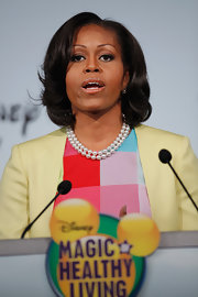 Michelle Obama's short wavy 'do at the Disney news conference had a chic retro feel.